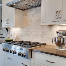 white shaker cabinets with quartz countertops. traditional white shaker cabinets \u0026 marble subway tile with quartz countertops t