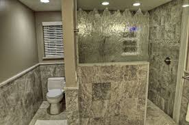 travertine tiled doorless shower with tiled half wall