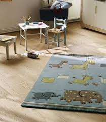 kids room special esprit lucky zoo kidsroom rugs soft pastel beige with blue and green