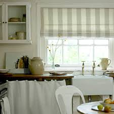 roman blinds kitchen. Beautiful Kitchen The Pole Threads Straight Through A Metalrimmed Eyelet Combining Curtains  And Roman Blind As Seen Here Creates Softer Look Blind For Blinds Kitchen Ideal Home