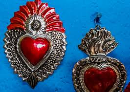 milagros spanish for miracles affixed to wooden hearts have a long history as these metal icons were originally purchased in front of churches