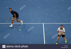 Beijing, China. 6th Oct, 2018. Oliver Marach (R) of Austria/Mate Pavic of  Croatia compete during the men's doubles semifinal against Ivan  Dodig/Nikola Mektic of Croatia at the China Open tennis tournament in