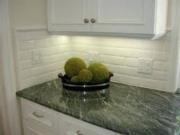 dark green tile backsplash dark green granite with white cabinets