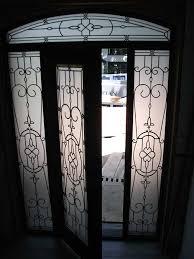 wood grain door glass design front door with 2 iron art side liteatching