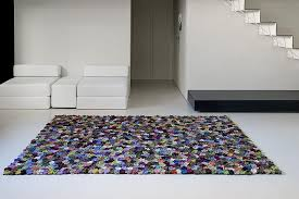 This rug reminded me of another rug I saw on Pinterest. This time it's a  granny square rug by Kasthall called Karin. Here the grannies are printed  on the ...