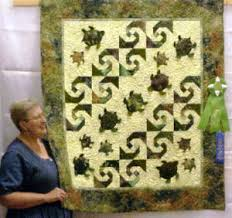 Baby Honu Quilt Pattern by Lisa Boyer & Sheila bought my quilt pattern during her trip to Kauai and made this  gorgeous quilt. As you can see, the judges loved it! Adamdwight.com