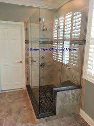 custom shower glass frameless door with glass panels installed with channel on granite curb this