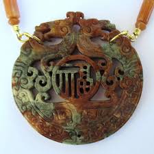 carved jade dragon pendant on amber and red agate necklace with gold vermeil accents to expand