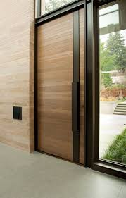wood clad modern front door with a black steel strip and handle
