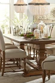 the havertys avondale dining collection is rustic and chic with it s vine oak finish table and natural colored chair upholstery