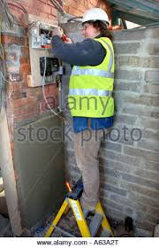 old electrical switches and fuse boxes stock photo royalty an electrician removes old electricity fuse boxes and installs a memera consumer unit uk stock