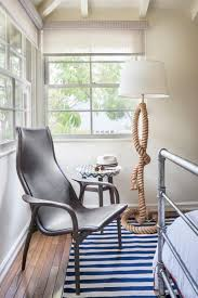 contemporary silver chair in bedroom with coastal rope stand lamp and blue and white striped rug