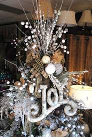 View in gallery Twigs, burlap, styrofoam balls, and ribbon combined in a  detailed tree topper
