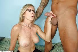 Mature blonde giving handjobs