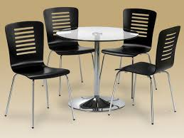 glass round dining table and 4 chairs. glass round dining table and 4 chairs