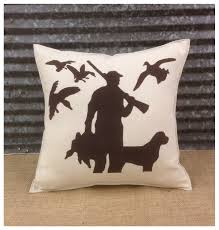 decorative pillow with a hunter with his dog and ducks complete