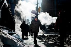 People brave cold weather as they walk on the street in New York on January  5