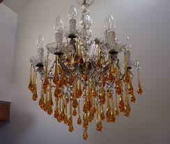 cur stock 1950s italian decorative 9 light chandelier clear glass centre and arms with solid amber glass drops diameter 50cm