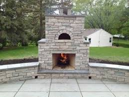 Outdoor Fondulac Stone Fireplace and Pizza Oven in St. Louis Park, MN -  Traditional - Patio - minneapolis - by English Stone