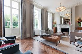 lavish high ceilings tall window ideas with regtangular beige wood soft ottoman and white electric fireplace mantels also gray fabric fl pattern curtain