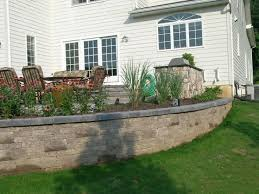backyard raised patio ideas. The Retaining Walls For This Raised Patio Create Beautiful Planters With Custom Landscaping. Backyard Ideas U