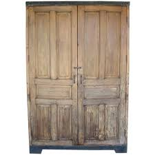 antique door armoire wardrobe or cabinet with iron banding for