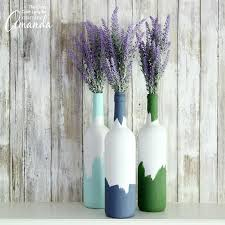 Painted wine bottles make a perfect vase or centerpiece for flowers.  Recycle your empty wine