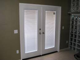 white exterior door with blinds between glass
