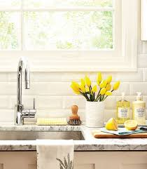 clean kitchen: kitchen marble counter flower vase yellow tulips window cutting board spring cleaning organized sink