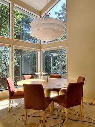 high window floor wall in dining room color theme with contemporary style tan casual dining room lighting