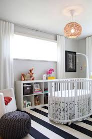 baby room furniture ideas. an oblong crib surrounded by black white and gray looks modern but relaxed with bright toys a natural wood light fixture in this sweet nursery baby room furniture ideas