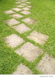 garden pathway. A Stone Pathway On Garden Lawn. T