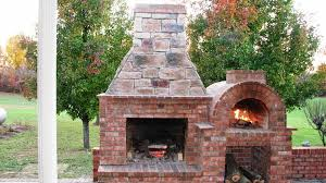 image of outdoor fireplace with pizza oven kits