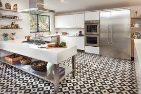 black and white kitchen floor tiles by granada tile are the focal point of this airy