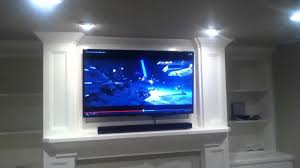 installation on samsung duo core smart tv with sound bar above fireplace