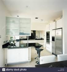 Glazed Kitchen Cupboard Doors Cupboard With Opaque Glazed Doors Above Black Granite Topped Stock