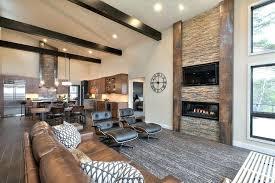 modern rustic living room with brown sofa gray area rug dark ceiling beams rugs