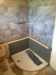 large format landscape ceramic wall tiling with bathroom installation in leeds