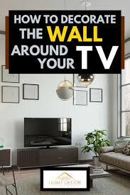 In the room above, we hung the tv along with an art print and a mirror for a dynamic and artistic arrangement. How To Decorate The Wall Around Your Tv Home Decor Bliss
