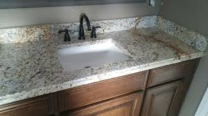 light color granite countertops bartop with sink cutout and dark cabinets