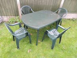 patio garden furniture set large plastic table and 4 stacking chairs in hockley es gumtree