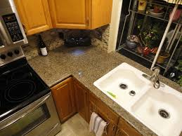 Granite Tile Kitchen Counter Kitchen Sink Area Finished With Lazy Granite Tiles And Bullnose