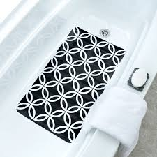 black white geometric circles bath mat in tub with towel