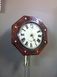 german postman wall clock inlaid with