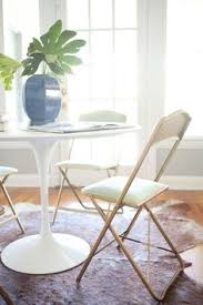 dining room with round table and folding chairs