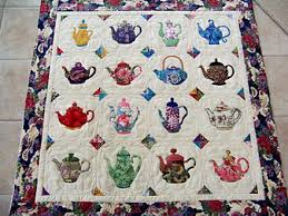 teapot wallhanging I have a pattern; hope I can make one someday ... & This would be so cozy to curl up with during tea time - Asian Teapot Quilt  made by Pat Besenhofer, quilt by Nancy Gambrel. Adamdwight.com