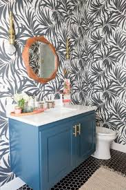 love the black and white palm frond wallpaper in this gorgeous bathroom by cc mike