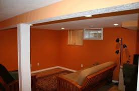 basement remodeling ideas photos. Simple Photos Orange Basement Remodeling Ideas With Black Floor Lamp And Wooden Living  Room Sofa For Photos