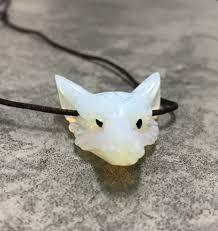 tags opalite gemstone opalite wolf carved wolf