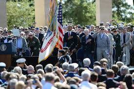 u s department of defense photo essay  u s president barack obama and wwii veterans render honors as u s army color guard presents the